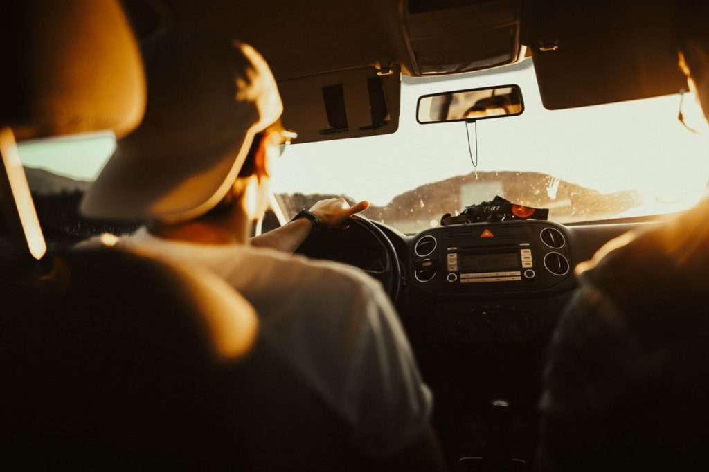 a man wearing a cap in the car